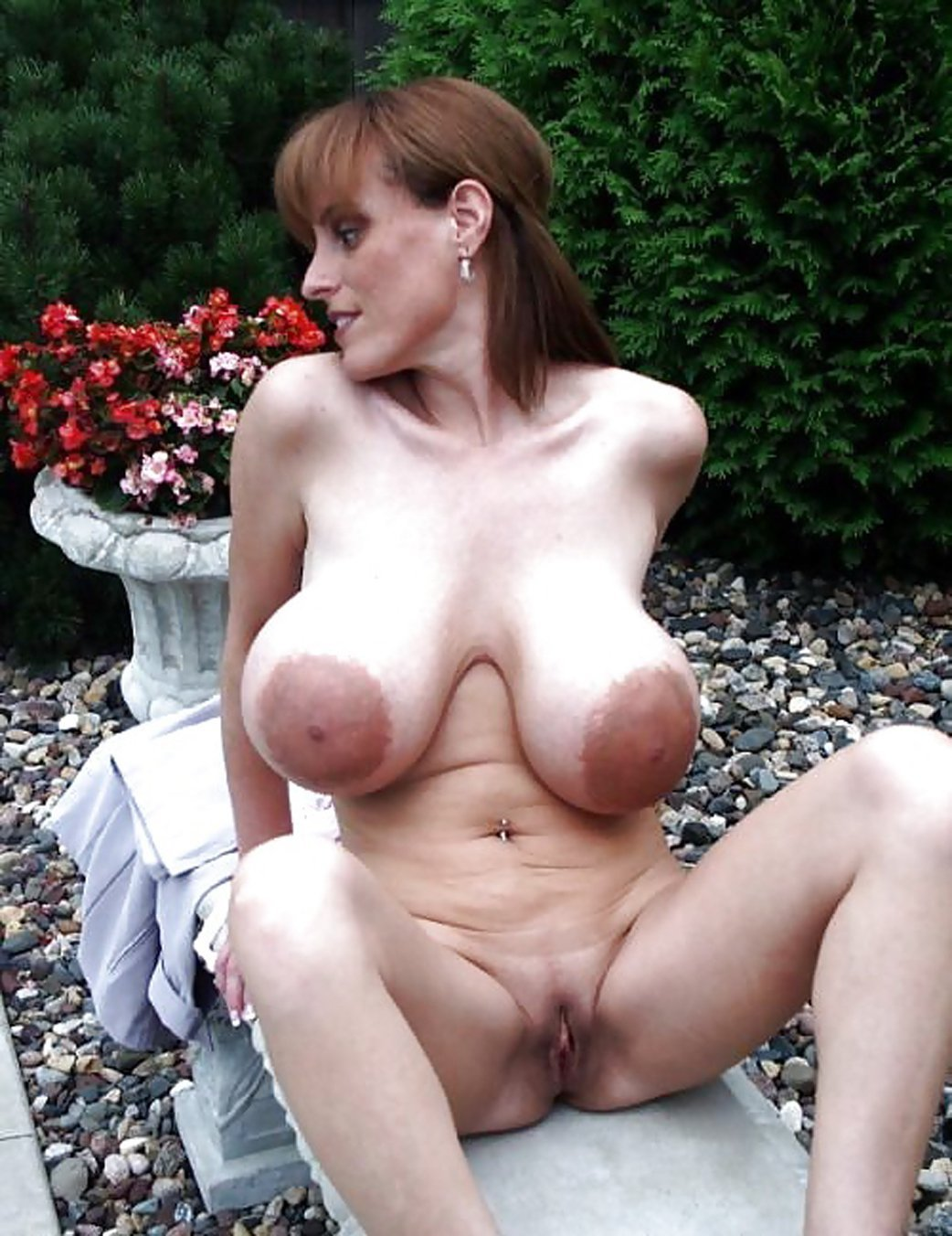 Elegant mature blonde teasing with her saggy boobs